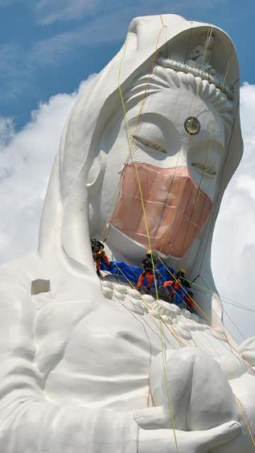Giant Buddhist goddess in Japan gets face mask to pray for end of Covid-19