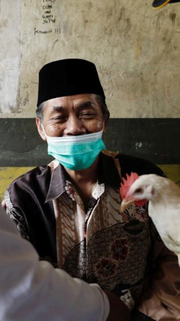 Chickens, cows, apartments offered up in Asia's vaccination lucky draws