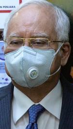 Najib sues Tommy Thomas